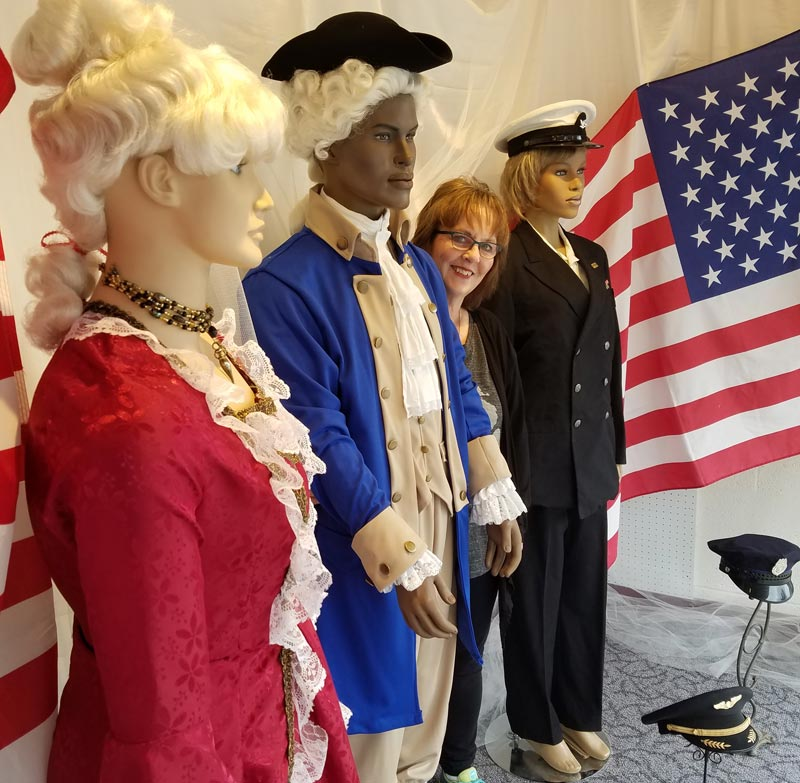 kostume room owner gayle vaartjes with patriotic costume display